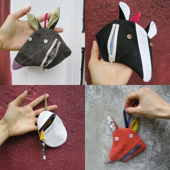 Это не только игрушка, но еще и сумочка (или кошелечек, как хотите) для разных мелочей.
