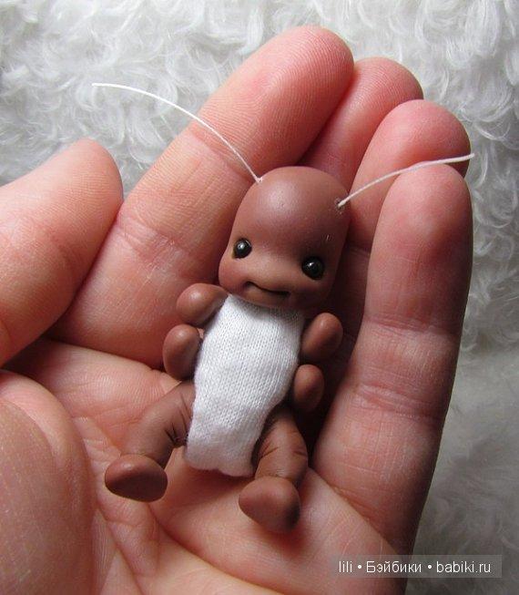 Поделка из глины куклы
